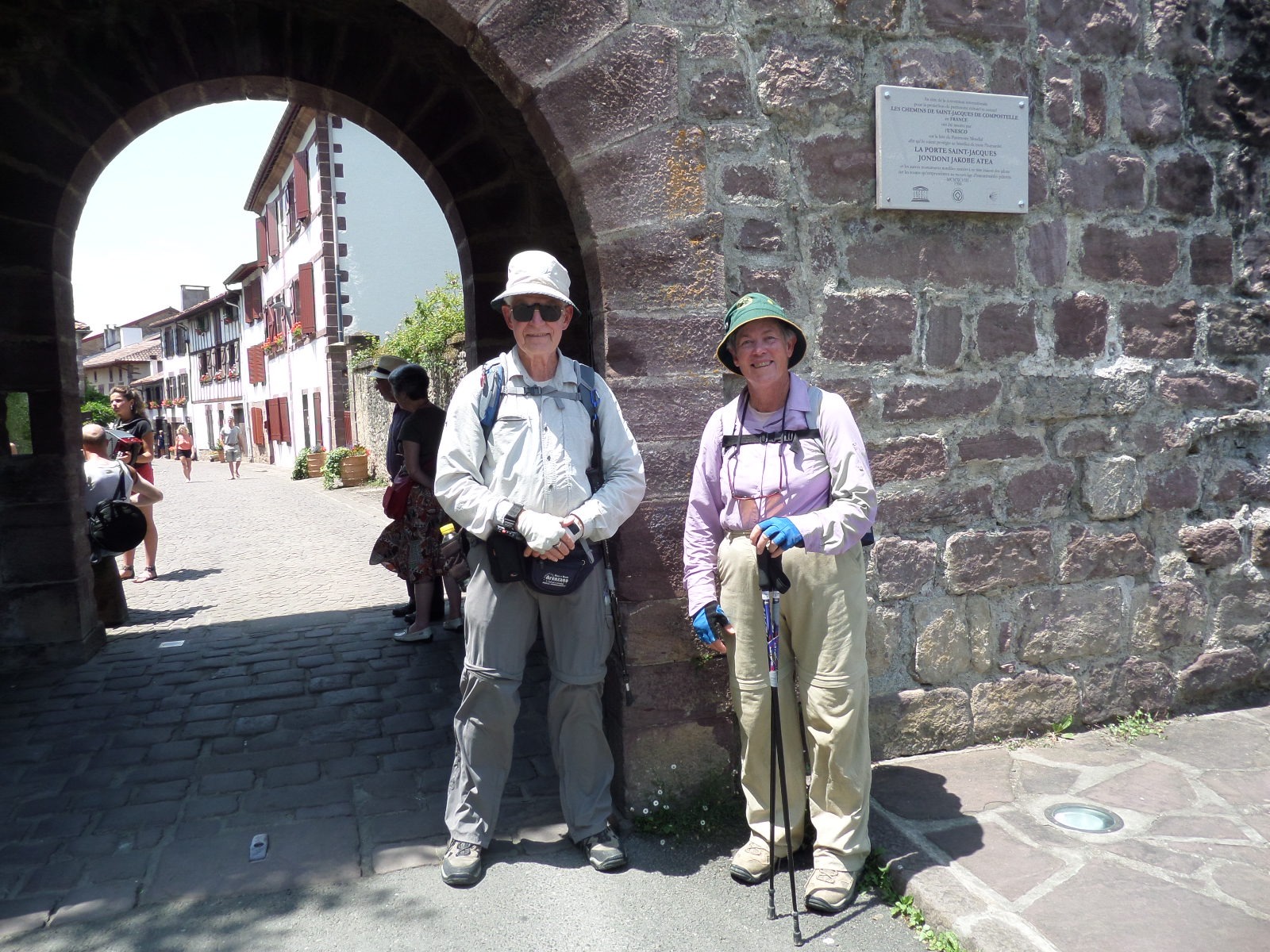 A photo of a man and a woman standing at the town gate of St Jean Pied de Port.