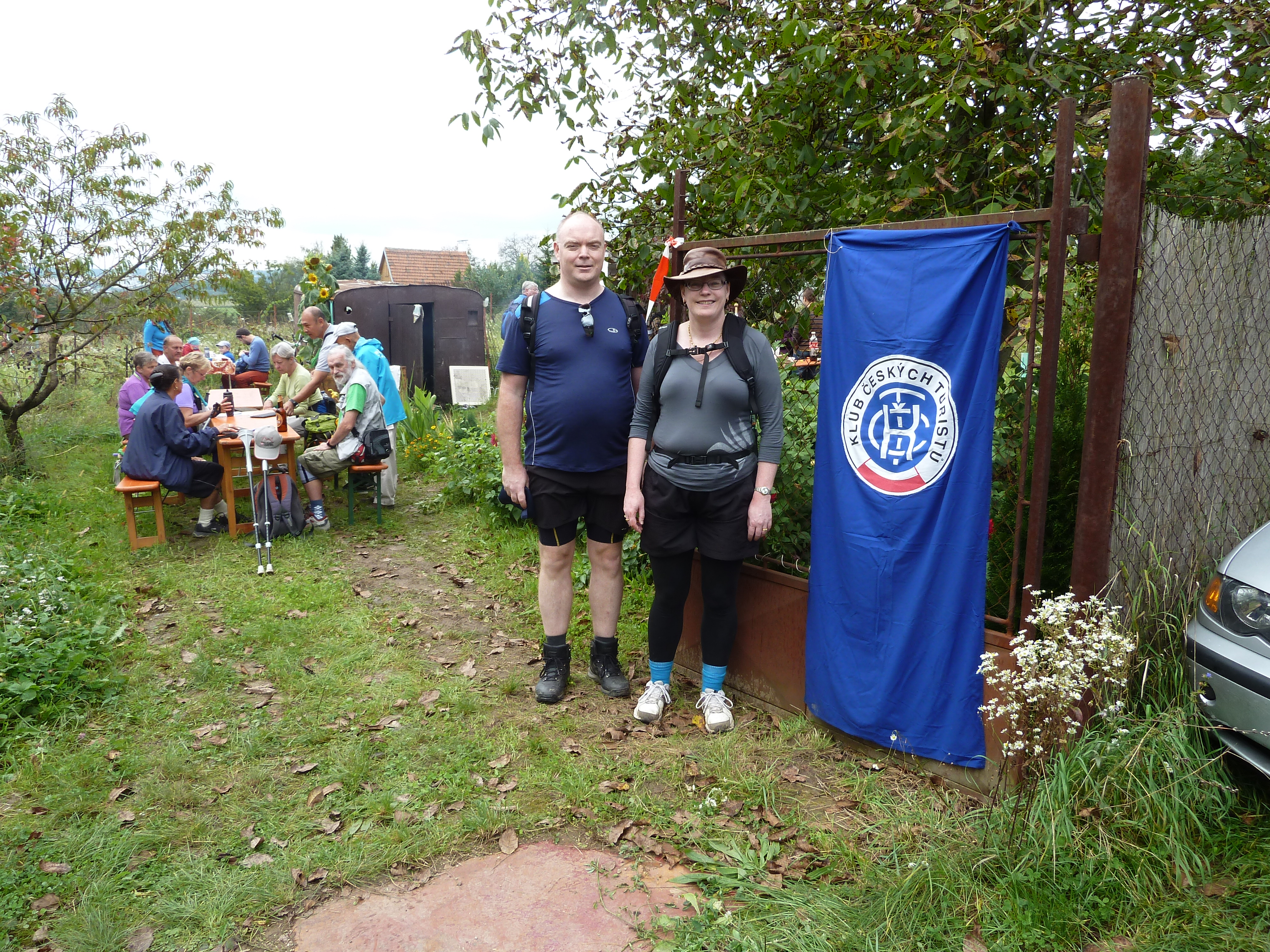 Man and woman standing near a blue banner in the Czech Republic.