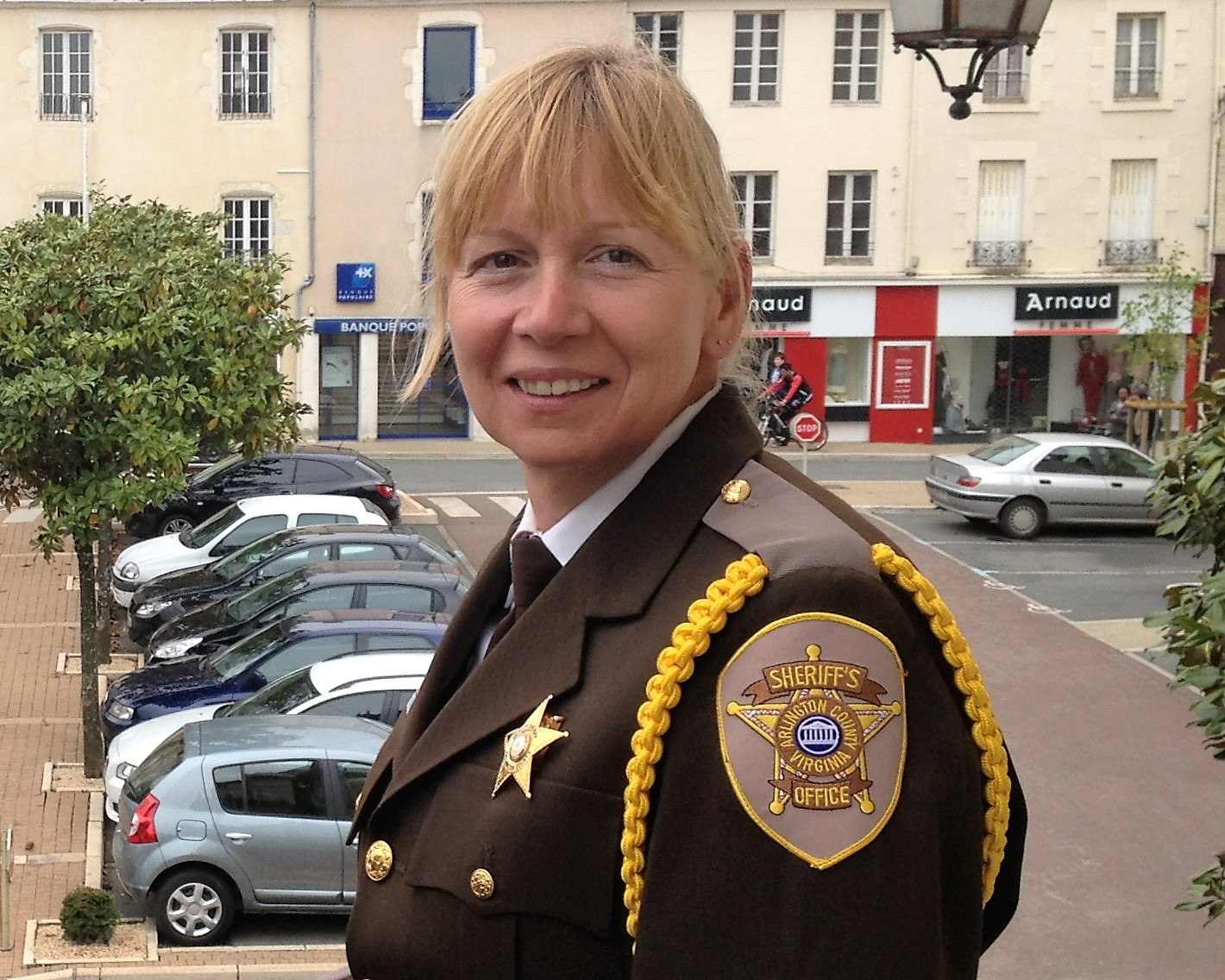 Photo of a woman sheriff officer in uniform.